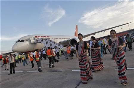 This file photograph shows air hostesses walk next to the parked Air India's Boeing 787-800 Dreamliner upon its arrival at the airport in New Delhi.
