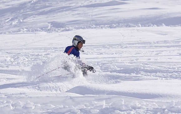 A boy learns to ski fresh powder at the Shemshak ski resort, 30km north of Tehran, Iran.