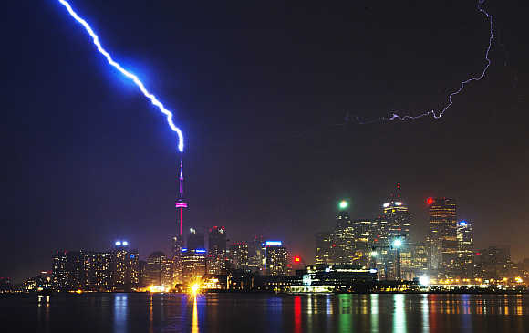 Lightning strikes the CN Tower during a thunderstorm in Toronto, Canada.