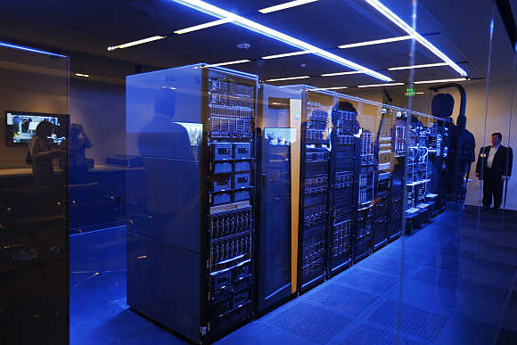 People peer into a server room during the opening of Hewlett-Packard's Executive Briefing Center in Palo Alto, California.