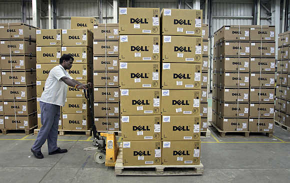 A man pushes a trolley full of Dell computers in Sriperumbudur Taluk, Kancheepuram district, Tamil Nadu.