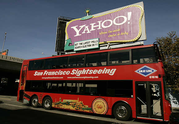 A tourist bus passes a Yahoo! sign in San Francisco, California.