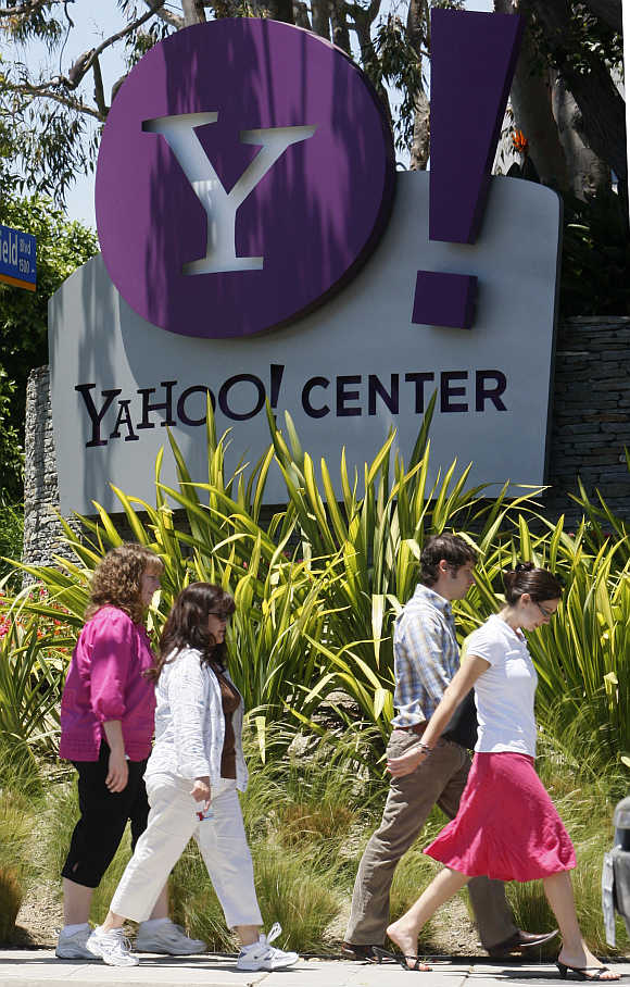 People walk past Yahoo! offices in Santa Monica, California.