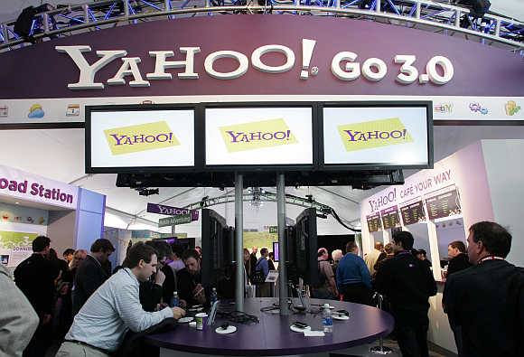 People look over displays at the Yahoo! booth during the Consumer Electronics Show in Las Vegas, Nevada.