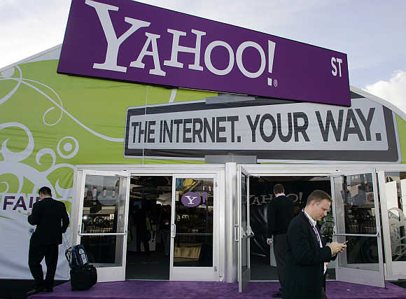 A man checks his mobile phone outside the Yahoo! booth during the Consumer Electronics Show in Las Vegas, Nevada.