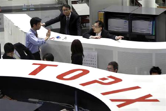 Employees of the Tokyo Stock Exchange work at the bourse.