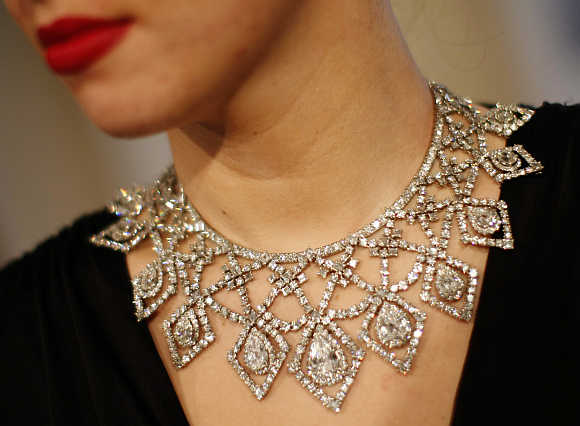 A model wears a diamond necklace by Cartier, estimated at $412,777 - 515,923, in London.
