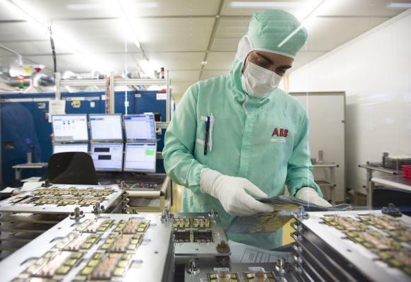 An employee works on the production of high-power semiconductors at a manufacturing plant.