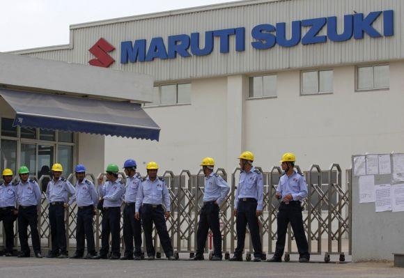 Private security guards stand outside the main entrance to the Maruti Suzuki India Limited plant in Manesar.