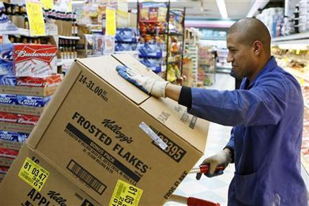 A store employee moves boxes full of of Kellogg's cereal in a supermarket in New York.