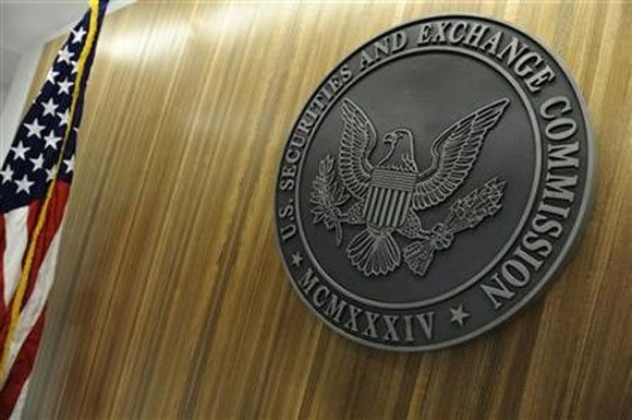 The seal of the US Securities and Exchange Commission hangs on the wall at SEC headquarters in Washington.
