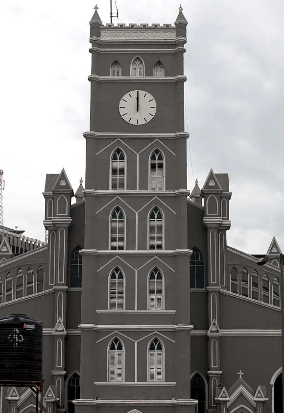 A clock at Lagos Cathedral Church strikes at 12 noon, in Nigeria.