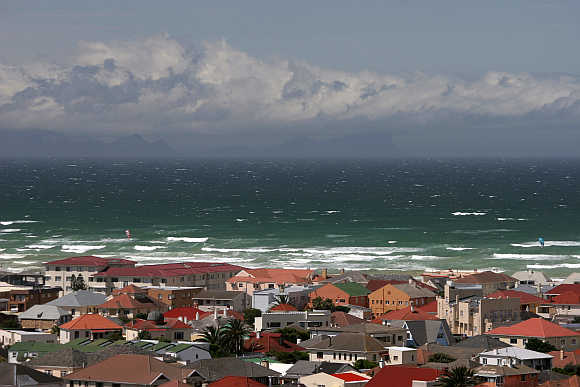 Waves crash the shoreline of Muizenberg, a suburb of Cape Town, in South Africa.