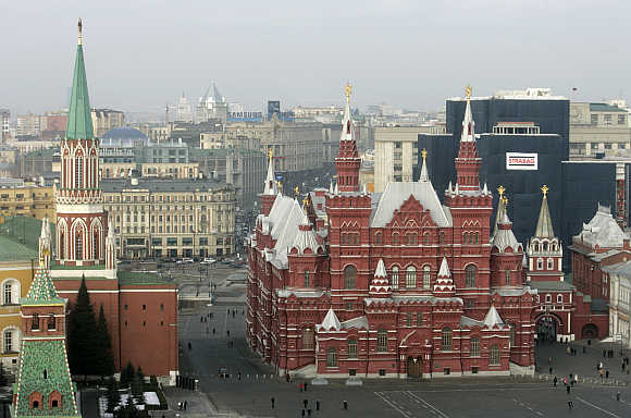 St Nicholas (Nikolskaya) Tower, left, and History Museum, right, in Moscow's Red Square, Russia.
