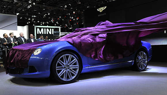 The wrap comes off the Bentley Continental GT Speed Convertible as it is unveiled at the North American International Auto Show in Detroit, Michigan.