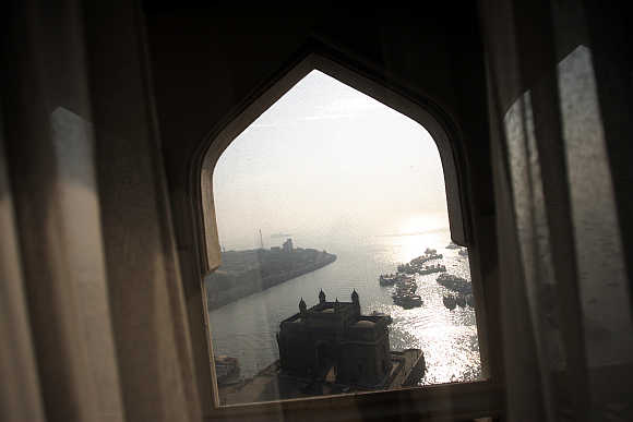 Historic Gateway of India is seen through the window of a room in Taj Mahal hotel in Mumbai.