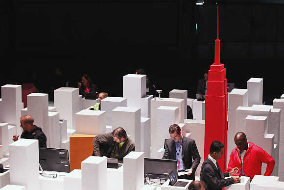 Members of the media examine Microsoft Surface tablet PCs in a scale model of New York during the launch event for the tablet and Microsoft's Windows 8 in New York City.