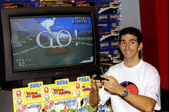Top British Formula One racing driver Damon Hill tries out Sega's 'Virtual Racing' video game.
