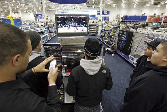 Visitors play on a Sony PlayStation 3 in Richfield, Minnesota, United States.