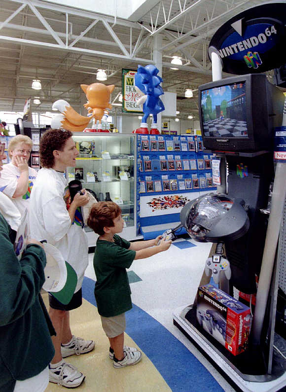A youngster tries Nintendo video game player in Raritan, New Jersey, United States.