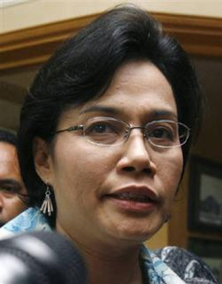 Sri Mulyani Indrawati speaks to reporters after attending a meeting at the Coordinating Ministry for Economic Affairs in Jakarta.