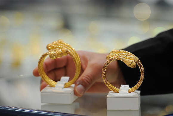 A woman looks at jewellery in a gold shop in Abu Dhabi, United Arab Emirates.