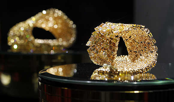 Gold jewellery is pictured on a stand at the Valenza international jewels exposition in Valenza, northern Italy.