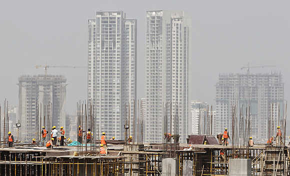 Labourers work at a construction site of a commercial complex in Mumbai.
