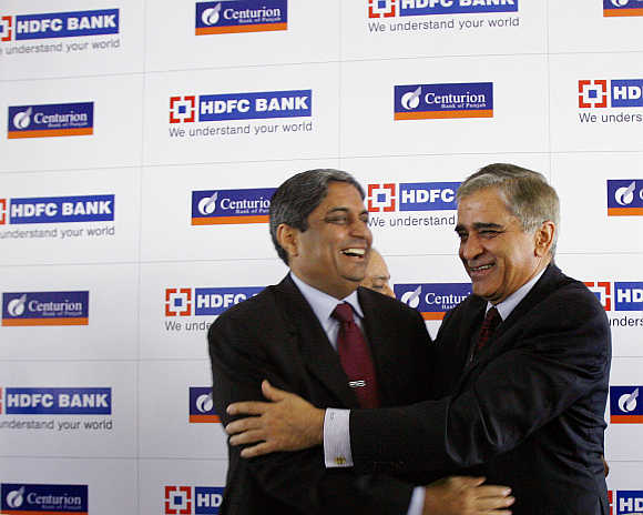Rana Talwar, right, former chairman of Centurion Bank of Punjab, with Aditya Puri, Managing Director of HDFC Bank, in Mumbai.