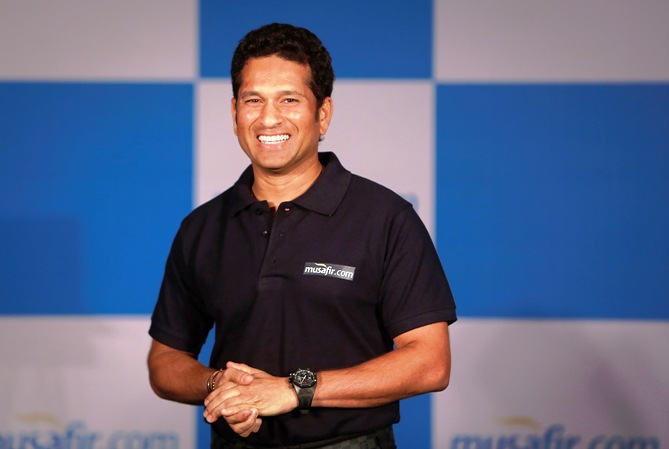 Sachin Tendulkar speaks during a news conference to launch a travel portal in Mumbai.