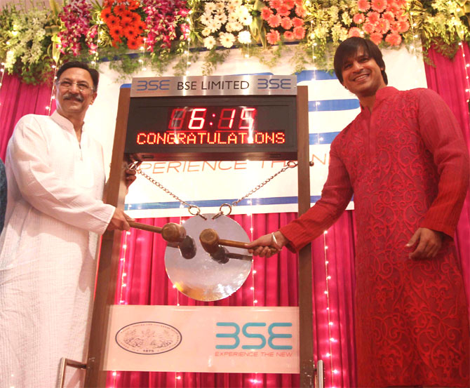 Suresh and Vivek Oberoi ring the opening bell of mahurat trading.