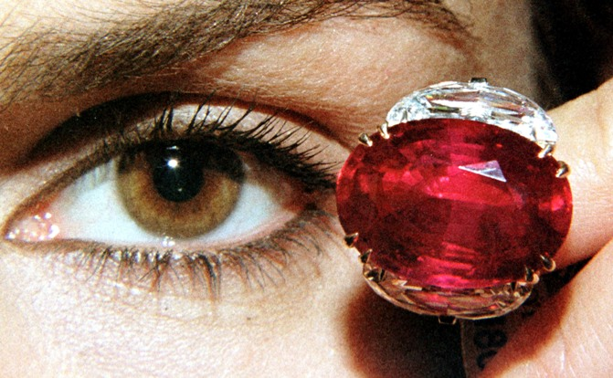 A model displays the 'Pink Star' 59.60 carat oval cut pink diamond at Sotheby's in Geneva.