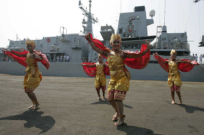 Dancers welcome the UK Royal Navy personnel of HMS Kent, docked in Tanjung Priok harbour, in Jakarta, Indonesia.