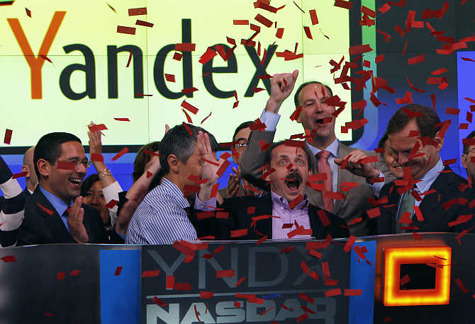 Founder and CEO Arkady Volozh, front, second right, celebrates as Yandex is listed on the Nasdaq exchange New York.