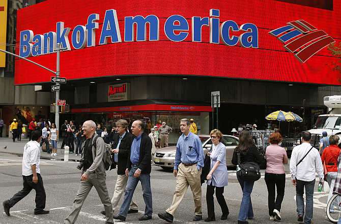 Pedestrians walk past a Bank of America branch in New York.