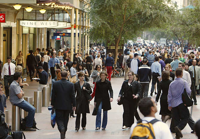 Lunchtime crowds flood into the Pitt Street Mall in Sydney, Australia.