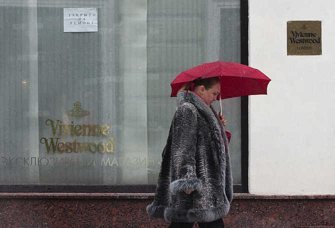 A woman walks past a Vivienne Westwood boutique in Moscow, Russia.