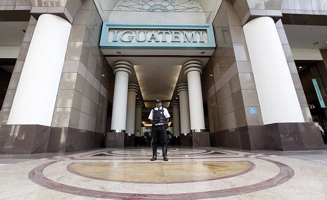 A security guard stands at the entrance of the Iguatemi Mall in Sao Paulo, Brazil.