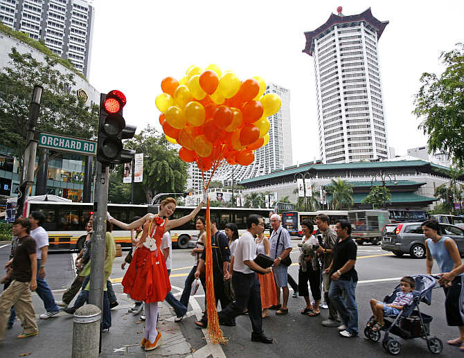 British model Lily Cole poses at a traffic intersection during a photo shoot on Orchard Road in Singapore.