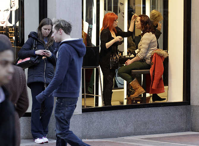A woman has her make up applied in the Brown Thomas department store on Grafton Street in central Dublin, Ireland.