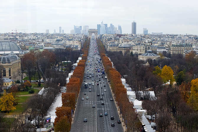 A view of the Champs Elysees Avenue and the Arc de Triomphe monument in Paris, France.