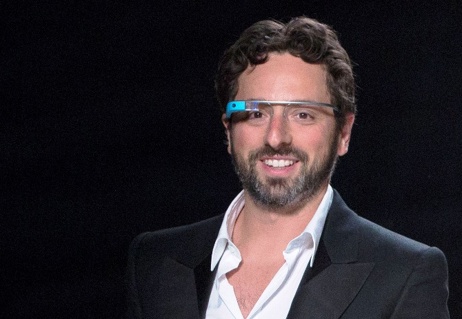 Google co-founder Sergey Brin walks the runway wearing new product 'Glass by Google'.