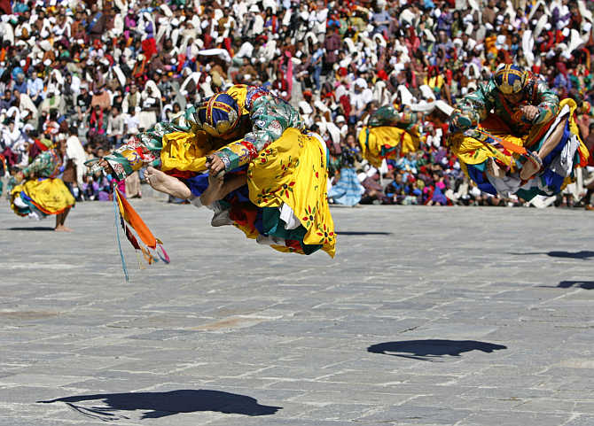 Dancers take part in the Tsechu festival in Thimphu, Bhutan.