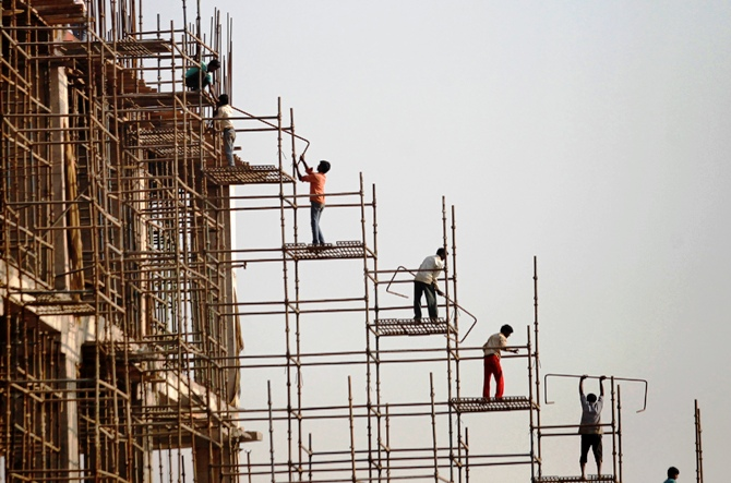 Labourers work at the construction site of a commercial complex in New Delhi.