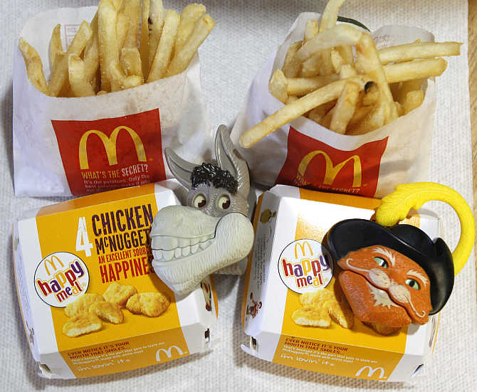 Two McDonald's Happy Meal with toy watches fashioned after the characters Donkey and Puss in Boots from the movie 'Shrek Forever After' are pictured in Los Angeles.