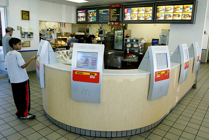 Computer terminals called kiosks line the counter at a McDonald's restaurant in the Denver suburb of Littleton, Colorado.