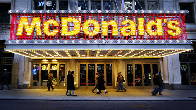 People pass a McDonald's restaurant on 42nd Street in Times Square in New York City.