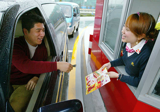 A customer buys food from McDonald's drive-thru in Shanghai, China.