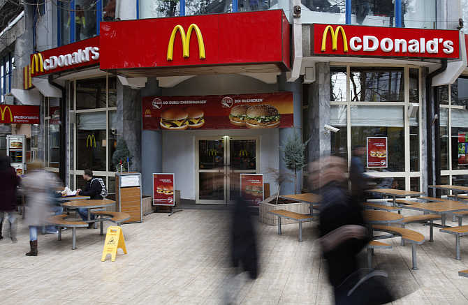 People walk in front of a McDonald's restaurant in Bucharest, Romania.