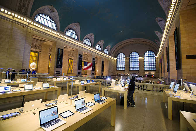 A man uses a computer at an Apple store inside Grand Central Station in New York City.